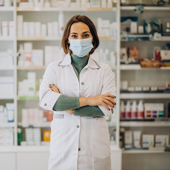 Young woman pharmacist at pharmacy